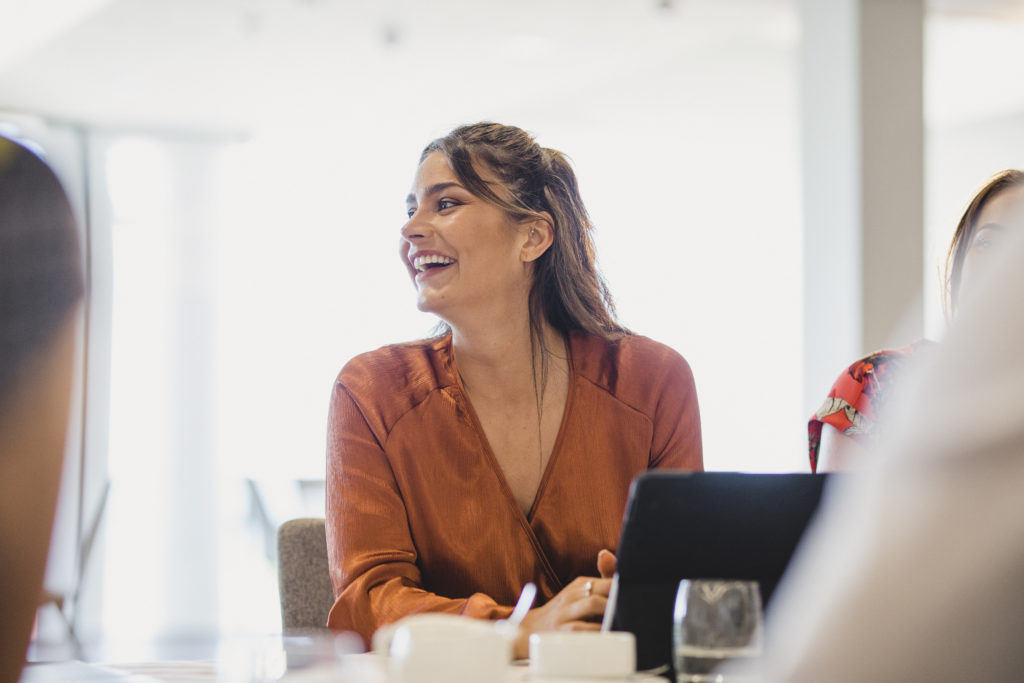 Woman smiling in meeting in office
